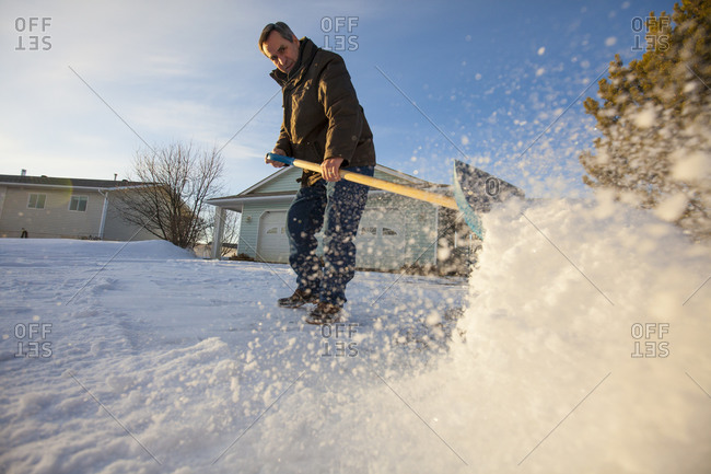 An man shovels snow in northern Alberta