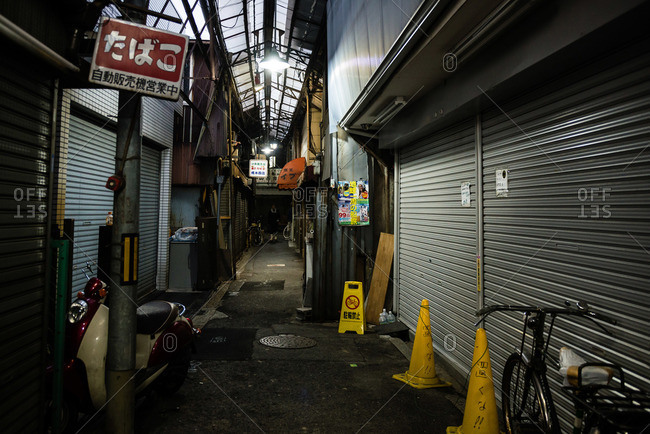 Osaka, Japan - December 31, 2015: Closed stores in shopping arcade in Korea Town in Tsuruhashi at night