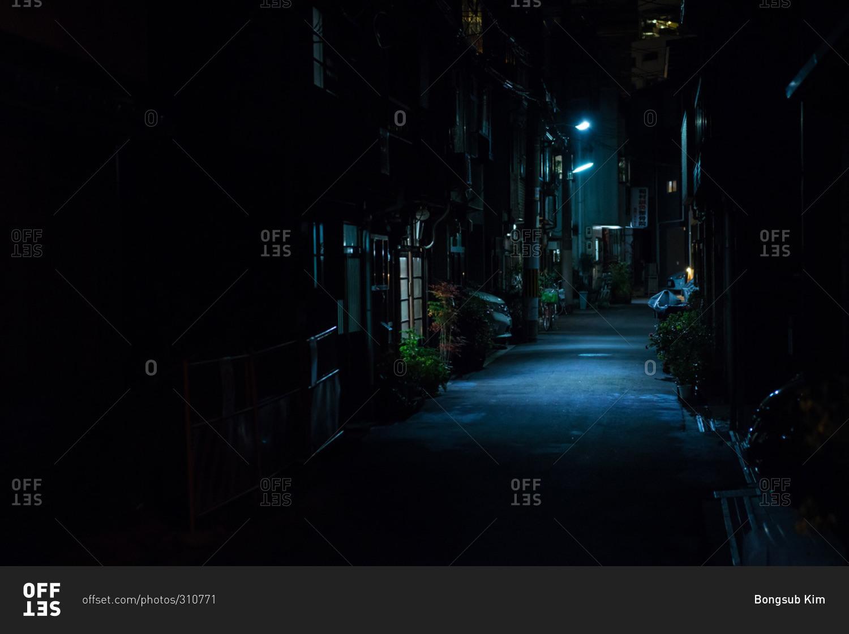 Osaka, Japan - December 29, 2015: Dark neighborhood alley