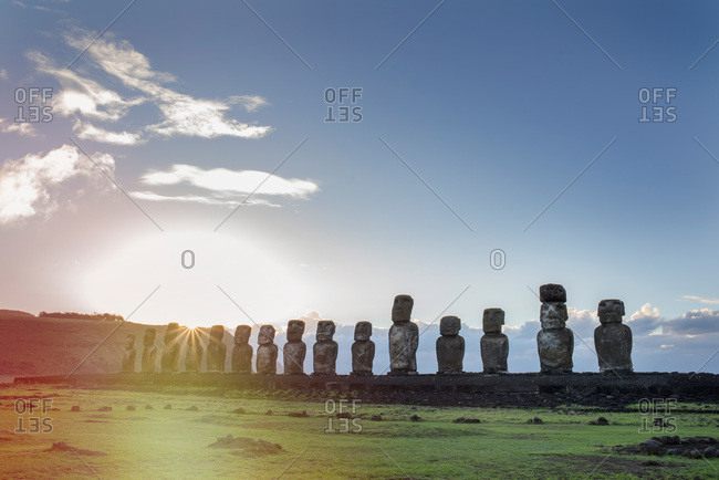 Sunlight behind maoi statues on Easter Island