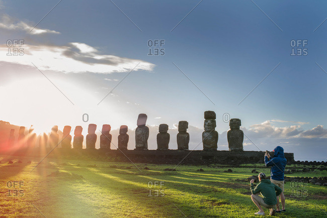 Tourists photographing maoi statues on Easter Island