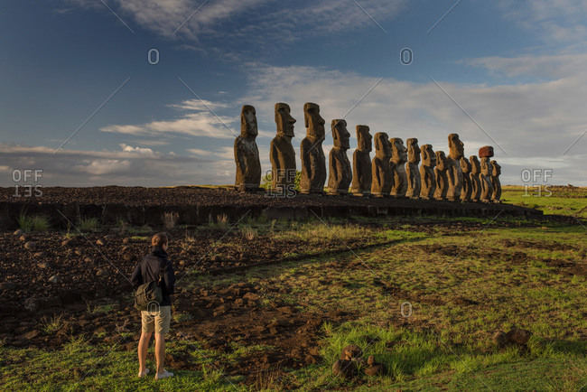 Tourist looking at maoi statues on Easter Island