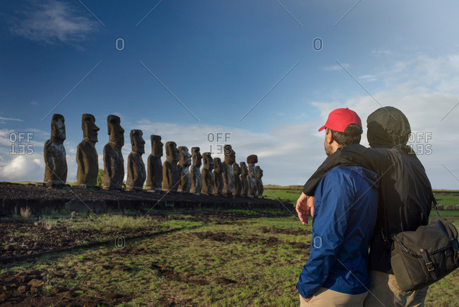Couple looking at maoi statues on Easter Island