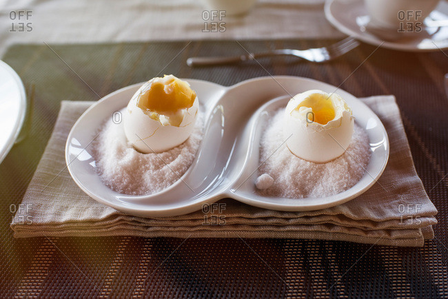 Two soft boiled eggs presented on a plate