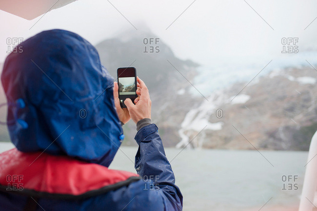 Tourist photographing the coast in Patagonia