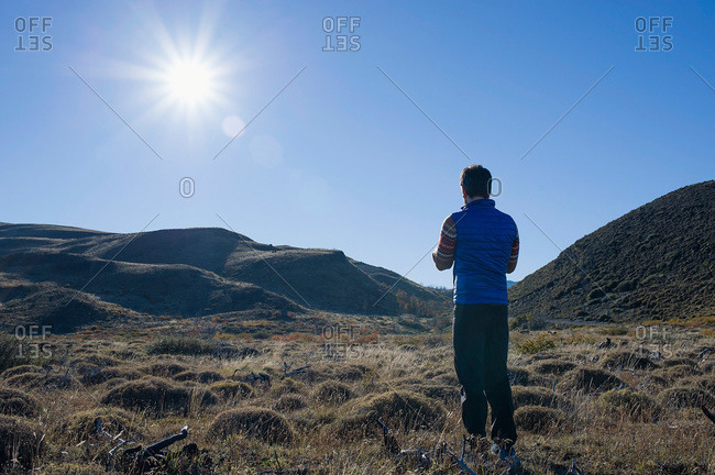 Man standing in a field in Patagonia