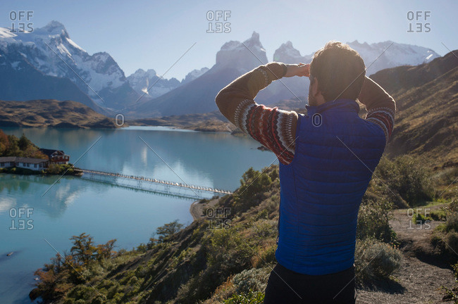 Man looking at view in Torres del Paine National Park in Patagonia