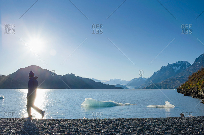 Man walking along shore in Patagonia