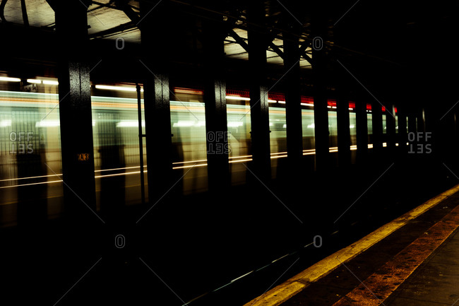 Blurred train in subway station