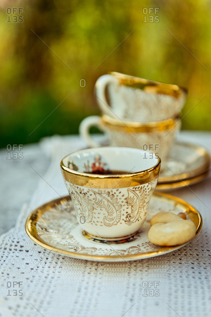 Ornate teacup on outdoor table