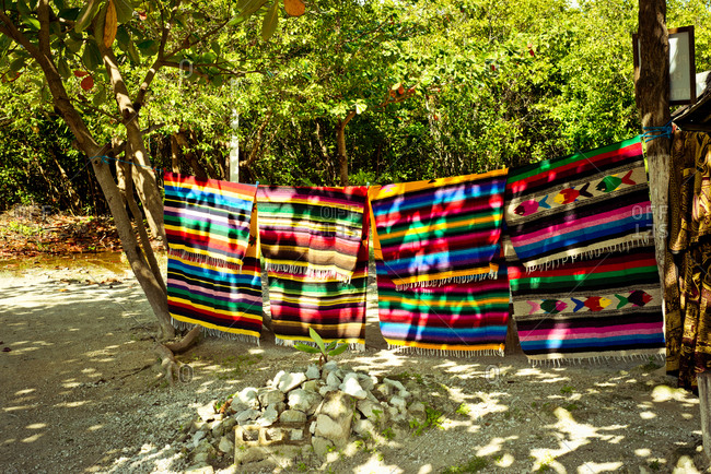 Traditional blankets hanging on line