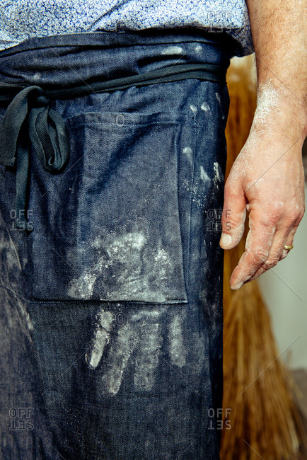 Man with flour covered apron