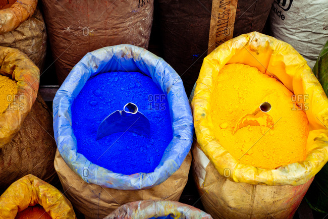 Blue and yellow dye powders