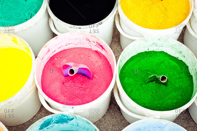 Various dye powders in buckets