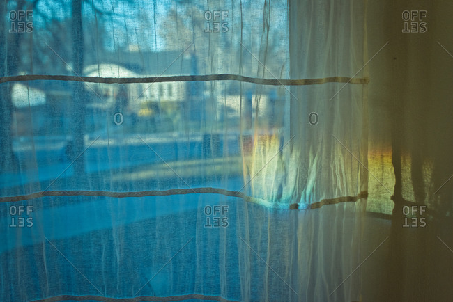 Curtain over window with street view