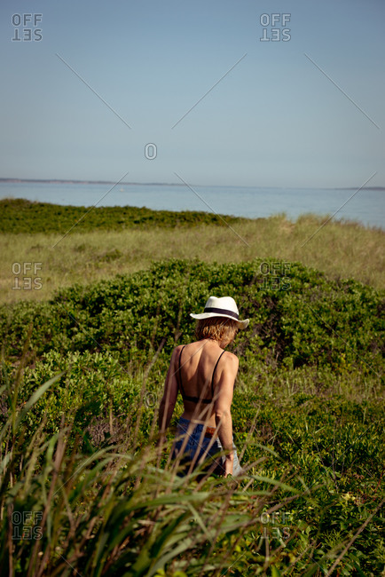Woman walking in coastal brush
