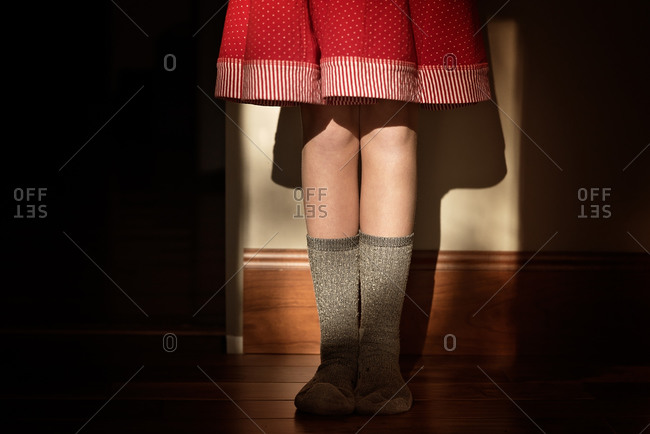 Girl in a skirt and wool socks