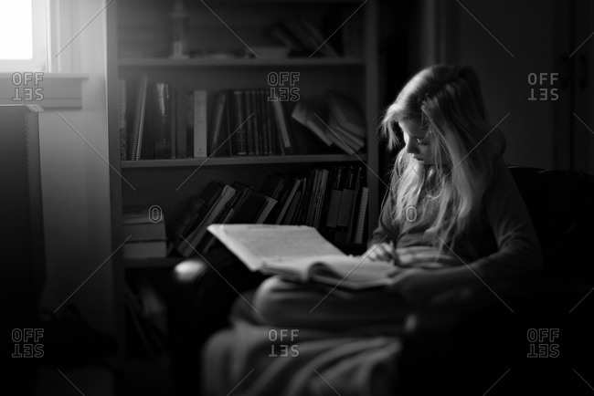 Girl reading a book in black and white