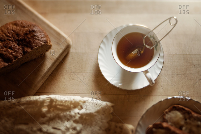 Cup of tea and bread on a cutting board