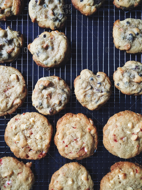 Chocolate chip and peppermint cookies cooling on a rack