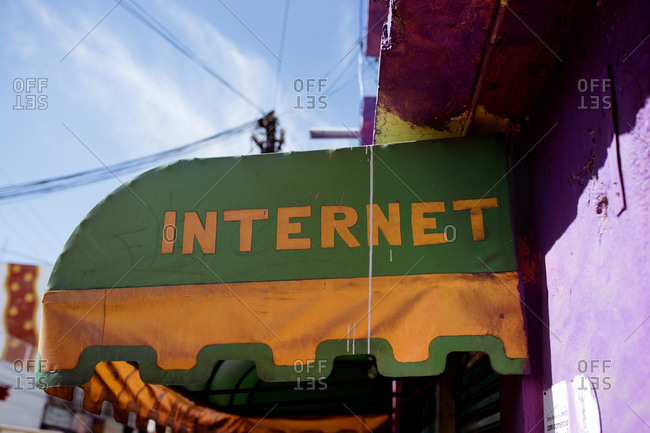 """Awning with the word """"Internet"""" on a purple building"""