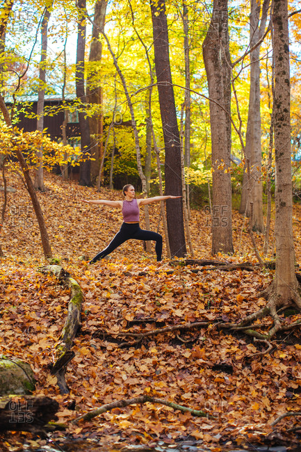 Woman doing yoga in the woods