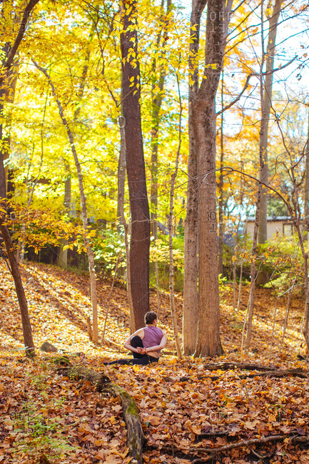 Woman stretching during yoga in the woods