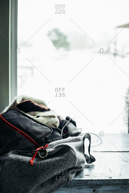 Backpack in front of a window