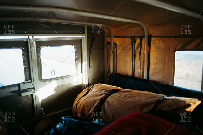 Interior view of vehicle with camping gear