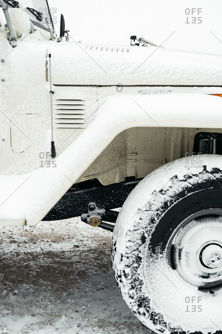 Close-up of snow covered tire on a sports utility vehicle