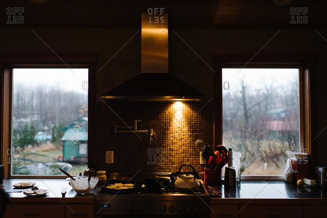 Making pancakes in kitchen in morning
