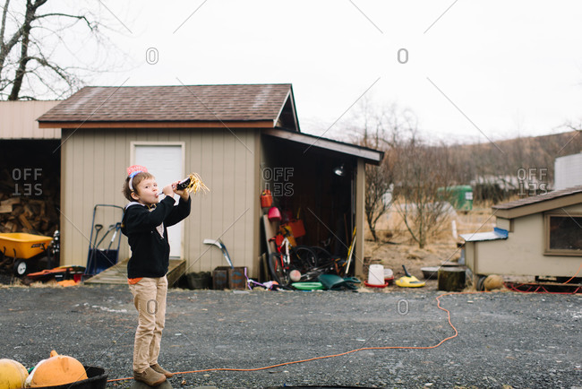 Child blowing horn to celebrate the new year