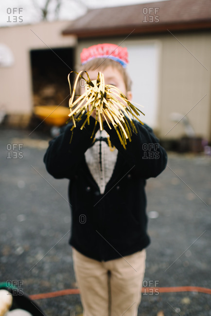 Child blowing party horn