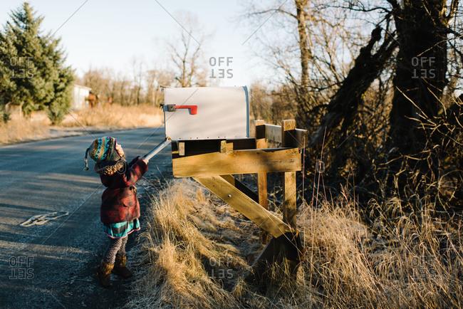 Toddler girl checking rural mailbox