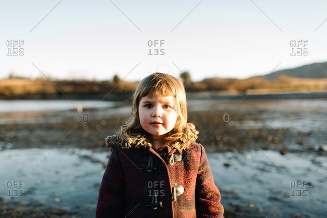 Portrait of a toddler girl outdoors on tidal flat
