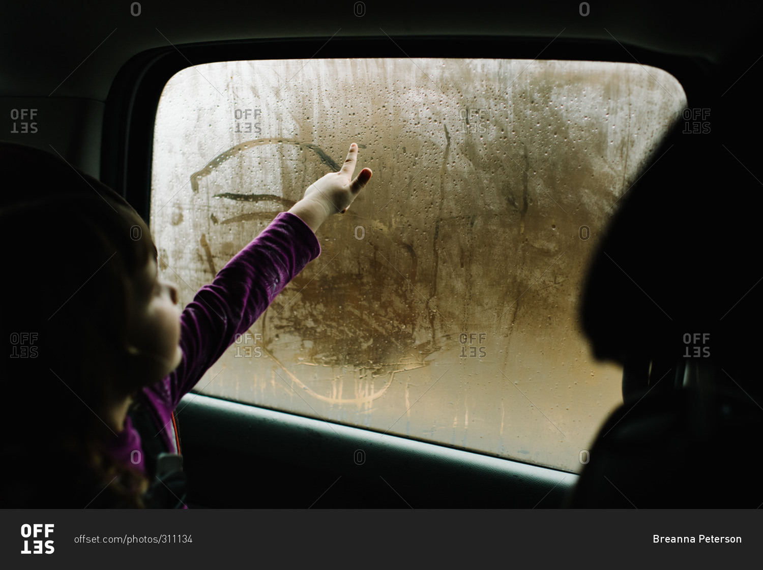 girl drawing in condensation of car window stock photo offset. Black Bedroom Furniture Sets. Home Design Ideas