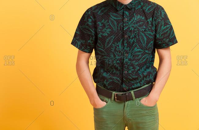 Close-up of man wearing black shirt and green pants