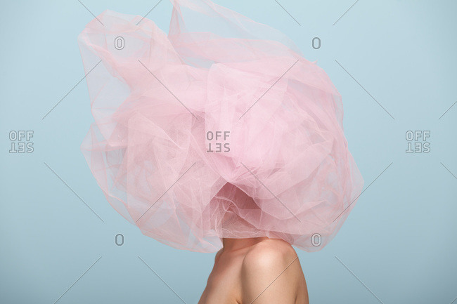 Woman with pink tulle covering her entire head