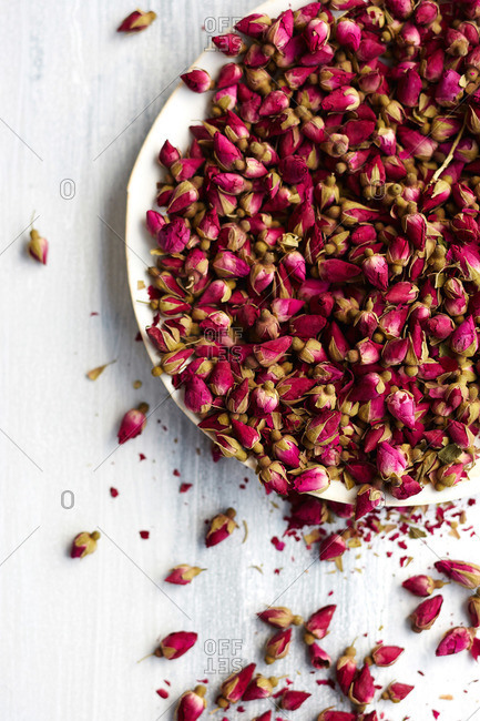 Bowl of small rose buds used as an ingredient in a cake