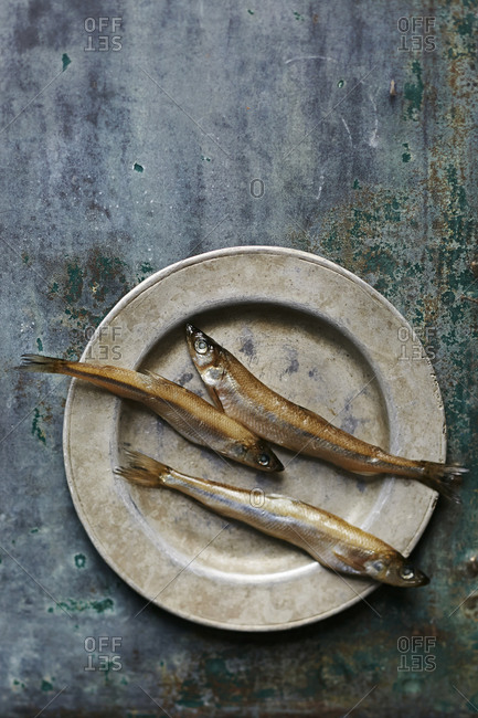 Three smelt fish on a plate