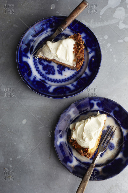 Slices of sweet potato pie with whipped cream