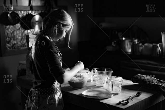 Girl making sweet rolls in a kitchen