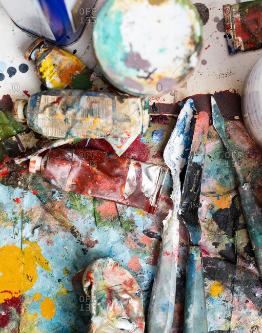 Paint and palette knives in an artist studio