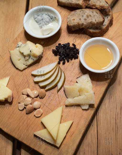 Cheese board with a variety of fruits and cheeses