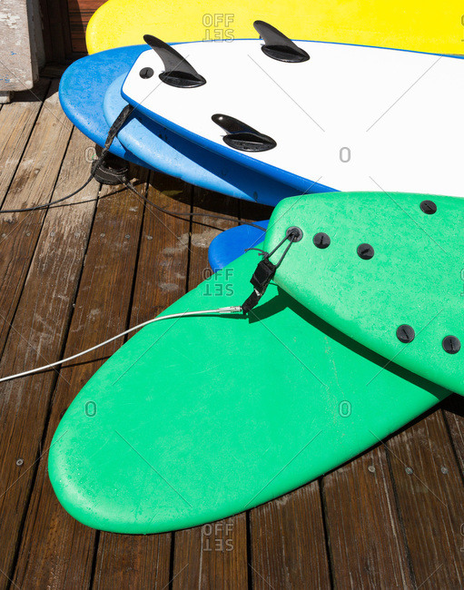 Surfboards on a wooden deck