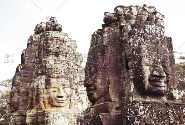 Carved stone faces at Bayon Temple in Siem Riep, Cambodia