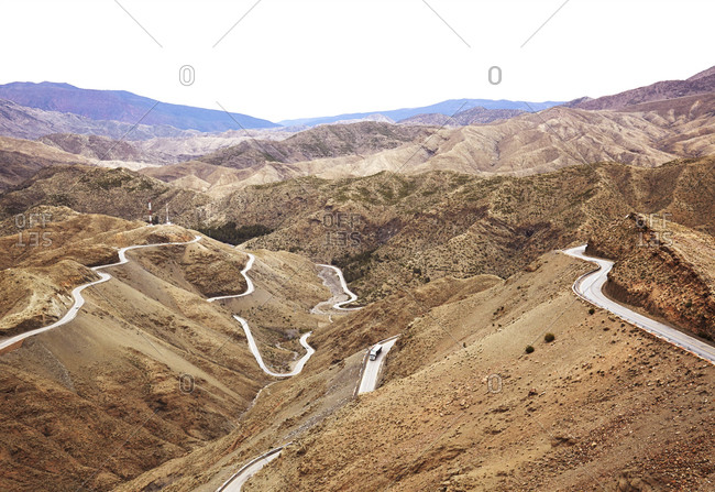 Truck on winding roadway through mountains in Morocco