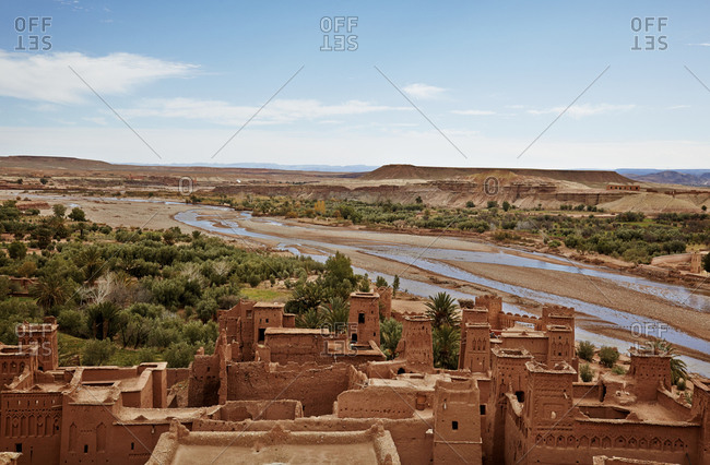 River flowing past ancient fortified city of Ait Benhaddou in Morocco