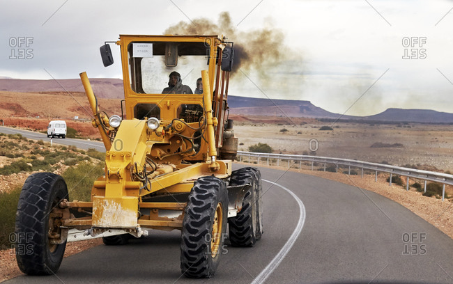 Morocco - January 12, 2015: Men driving tractor on road