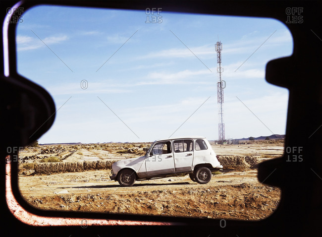 Morocco - January 12, 2015: View through window of vintage car in desert